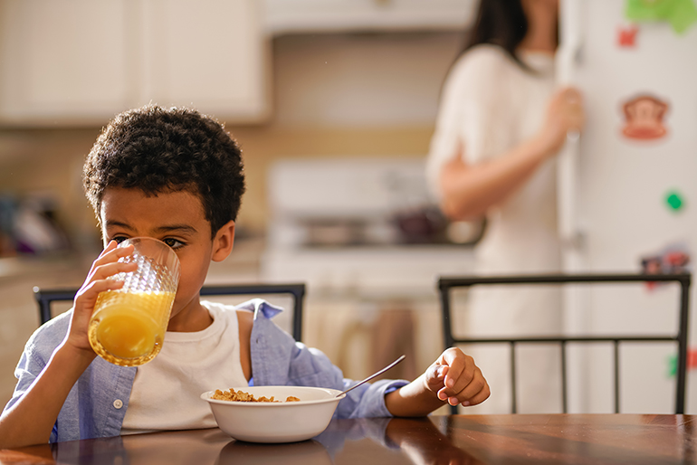 kid eating cereal and vitamin c